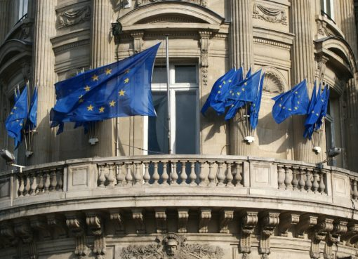 european union flags on building by David Mark